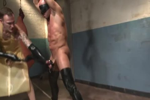 Muscled Hunk Suspended In The penis Locker